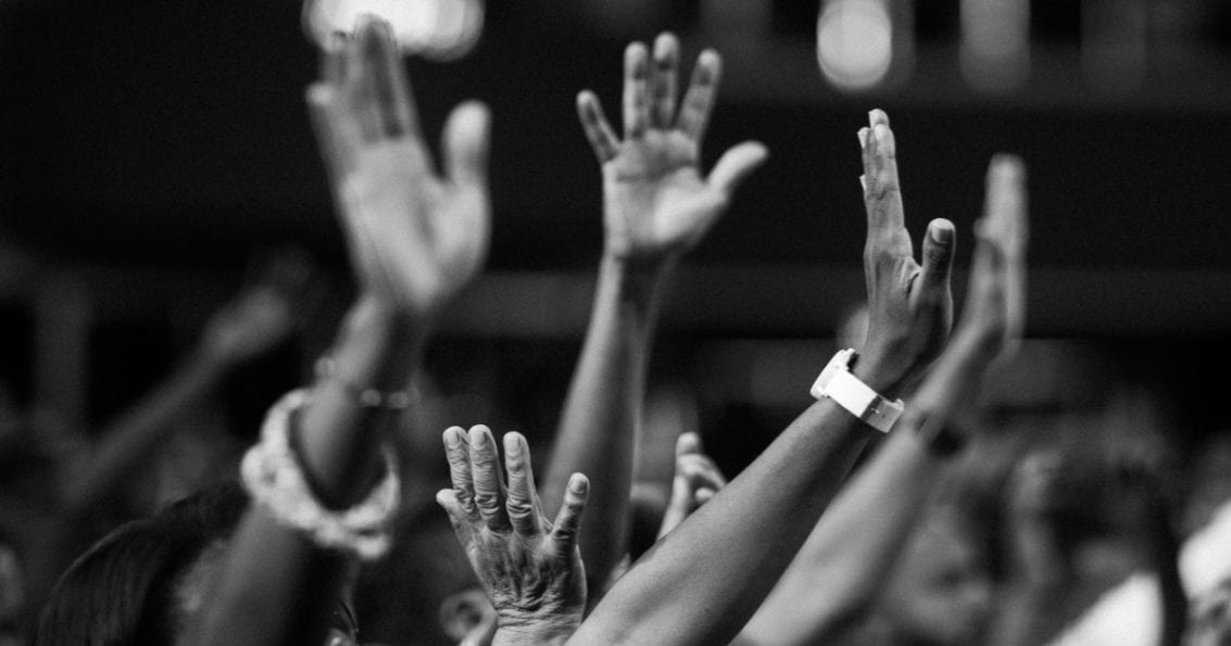 lifting hands in worship